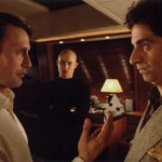 Le Chiffre hands Dimitrios half a Carta Mundi playing card, part of a non-grid recognition signal for terrorist funds